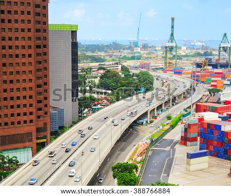 Modern highway and commercial port with many containers in Singapore - stock photo