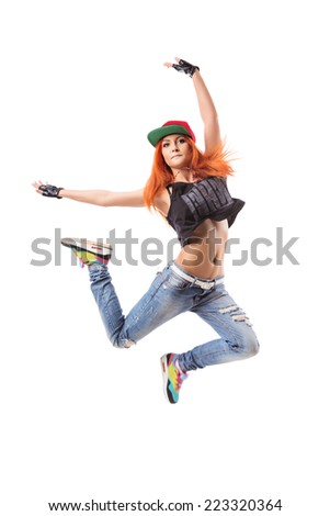 Modern hip-hop dance girl seat on white background. Young teenager with glasses bends