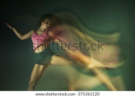 Modern hip hop dancer woman in motion blur - stock photo