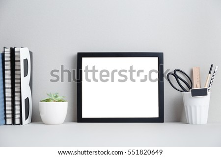 home decor photography. Modern home decor mock up  Creative desk with blank picture frame or poster Home Decor Mock Up Stock Photo 551820649