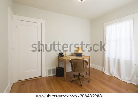 Modern home home office interior with furniture and wooden floor - stock photo