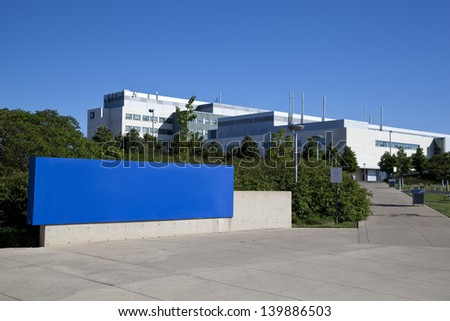 Modern hospital and sign with clear blue sky