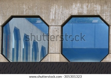 Modern hospital architecture with octagonal windows reflecting themselves