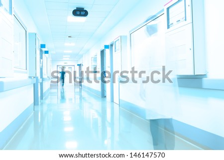 modern hospital corridor. Movement of medical personnel. - stock photo