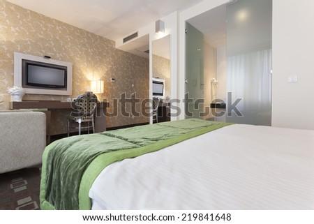 Modern hotel bedroom interior - stock photo