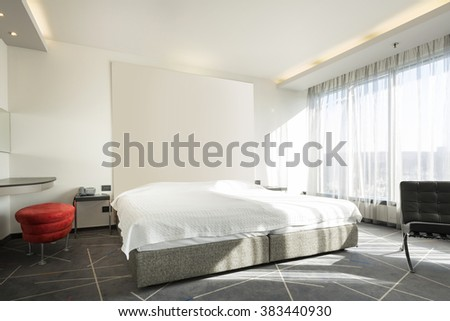 Modern hotel bedroom interior in the morning