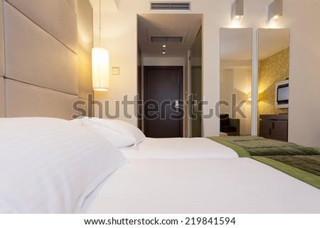 Modern hotel bedroom with bathroom - stock photo