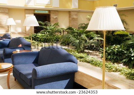 Modern hotel lobby with garden place for rest.