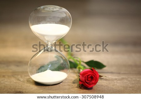 Modern hourglass and red rose with copy space. valentines day countdown.