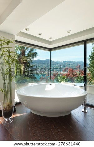 Modern house, beautiful bathroom, bathtub and windows  - stock photo