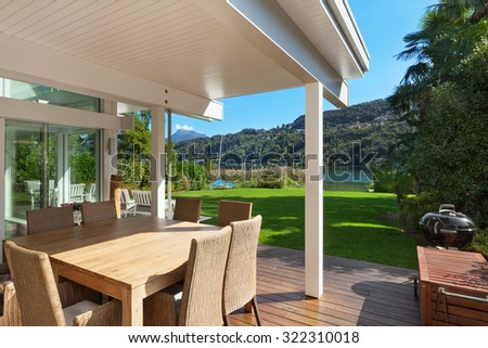 modern house, beautiful veranda with furniture - stock photo