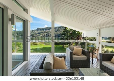 modern house, beautiful veranda with furniture - stock photo