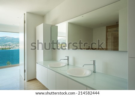 Modern house, detail bathroom, sinks and mirror