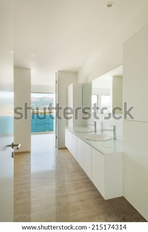 Modern house, detail bathroom, sinks and mirror - stock photo