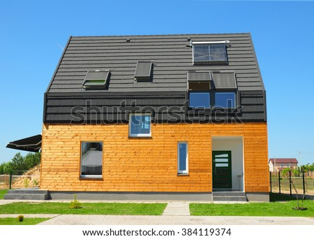 Modern House Exterior. Beautiful New Contemporary House with Solar Panels. - stock photo