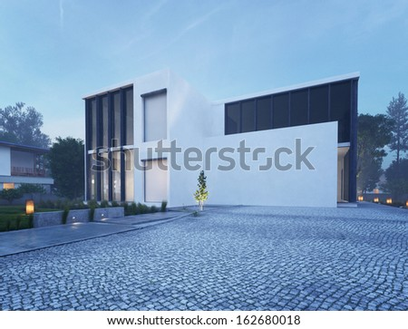 Modern house exterior with outdoor lighting at twilight - stock photo