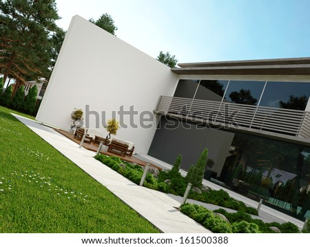 Modern house exterior with patio and garden - stock photo