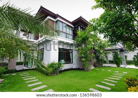 modern house with pool and garden. modern house in the garden with pool and i