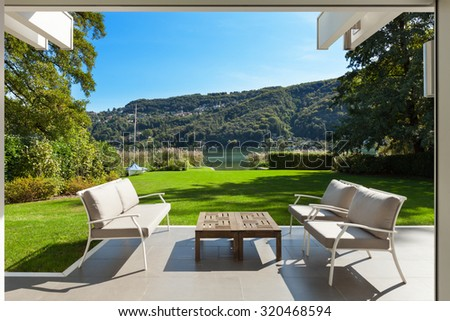 modern house outdoors, beautiful veranda in the garden - stock photo