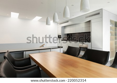 modern house, white kitchen, view from dining table - stock photo