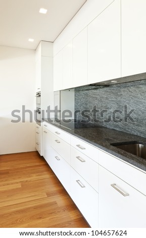 modern house with hardwood floor, view of the kitchen - stock photo