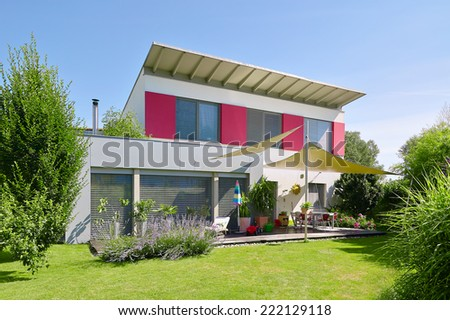 Modern house with nice garden - stock photo