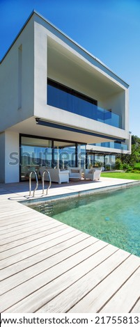 Modern house with pool in exterior - stock photo