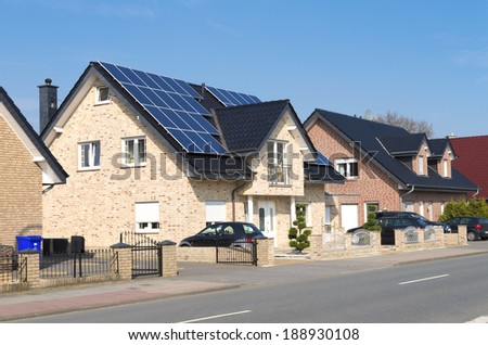 modern house with solar panels on its roof - stock photo