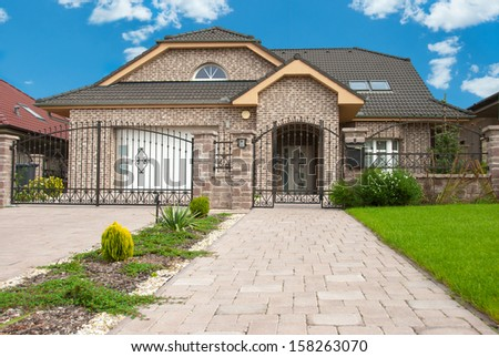 Modern house with stones with azure blue sky. - stock photo