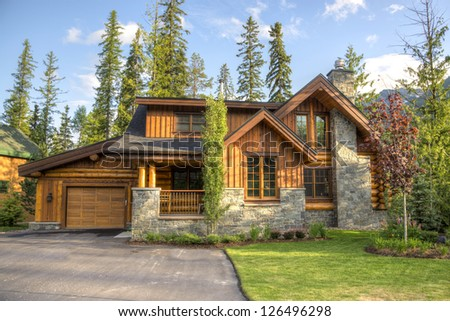 Modern houses located in a ski resort - stock photo