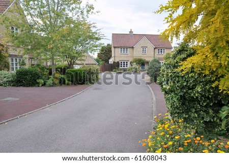 Modern Housing Estate Driveway in Autumn - stock photo