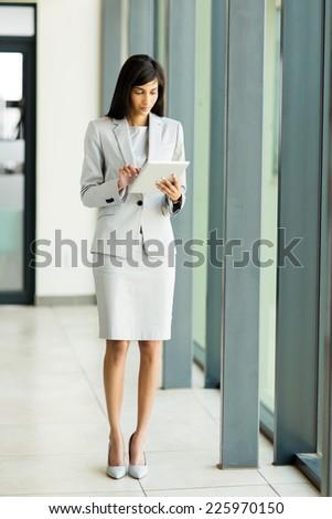 modern indian entrepreneur using tablet computer - stock photo
