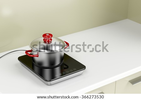 Modern induction cooktop with cooking pot in the kitchen - stock photo
