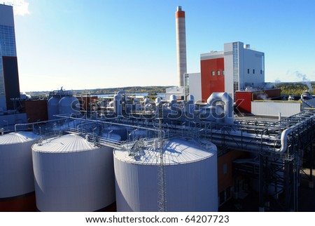 Modern industrial factory against blue sky - stock photo