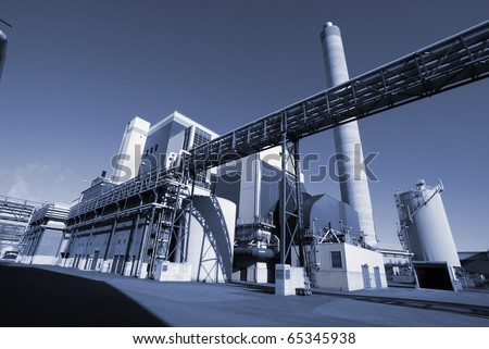 Modern industrial factory in blue tone - stock photo