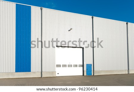 modern industrial unit with roller door - stock photo