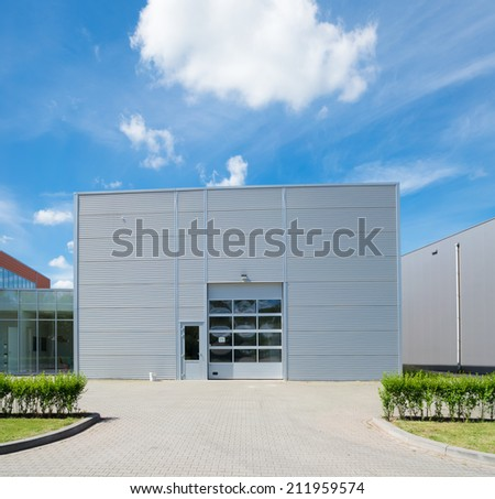 modern industrial unit with roller doors - stock photo