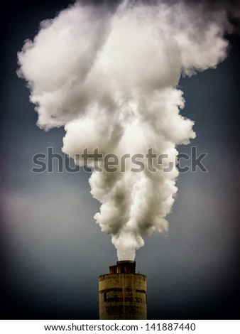 modern industry chimneys in front of gray sky - stock photo