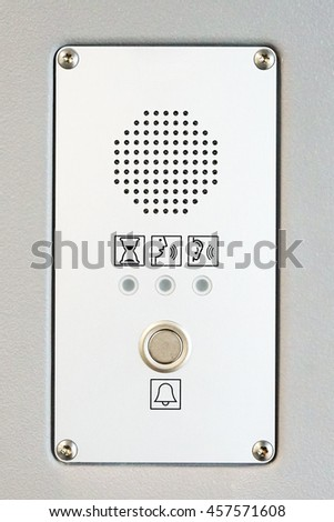Modern intercom panel built in a metal wall.