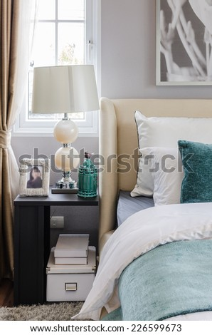 modern interior bedroom with table and lamp at home