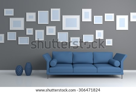 Modern interior composition of a sofa and pictures on a wall.