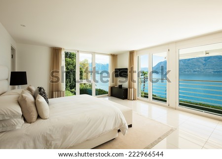 Modern interior design, comfortable bedroom - stock photo