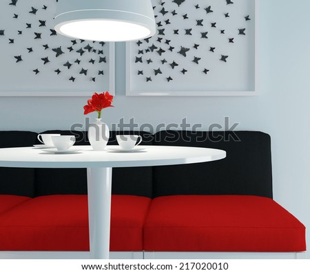 Modern interior design. Contemporary dining room. Round table with tea cups and flowers. - stock photo