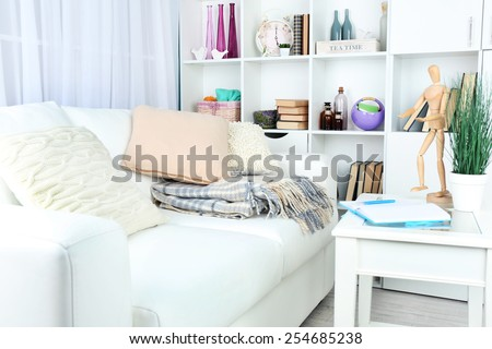 Modern interior design of living room in light colors, indoors - stock photo