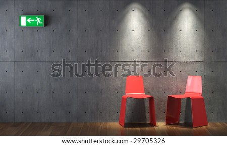 modern interior design of two red chairs on concrete wall with emergency exit sign - stock photo