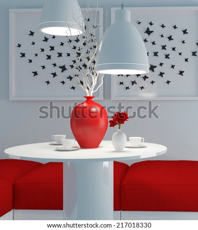 Modern interior design. White and red dining room. Round table with tea cups and flowers. - stock photo