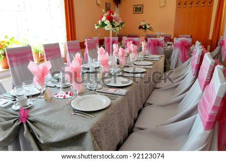 Modern interior, dining table with chairs