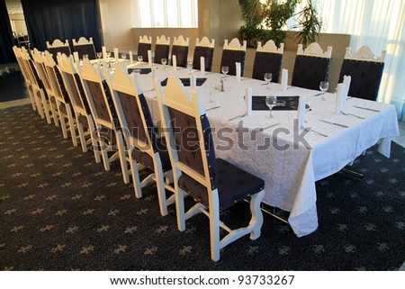 Modern interior, dining table with chairs - stock photo
