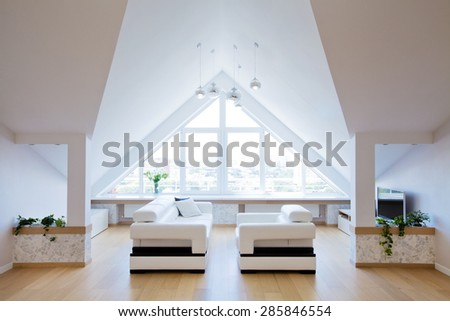 modern interior light a large apartment in the attic - stock photo