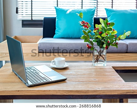 Modern Interior Living Room With Laptop On Table Top Sofa Background